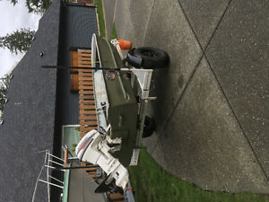 14 ft boat and registered trailer