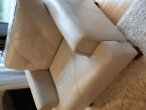 Genuine Leather Sofa and Chair like new.