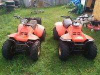 Two Suzuki LT185s