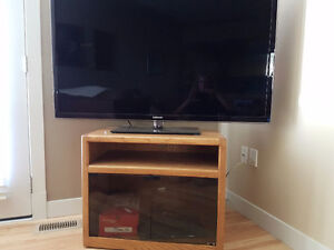 TV Stand with glass doors and on rolls