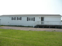 Large mini home on its owned 1 acre lot. Close to beach.