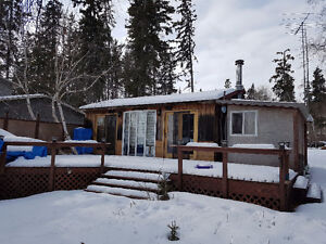 Emma Lake cabin and lot for sale.