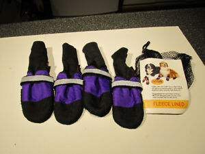 Brand new muttluks small size fleece lined leather boots.