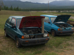 2 1992 ford Festiva's for sale for parts.