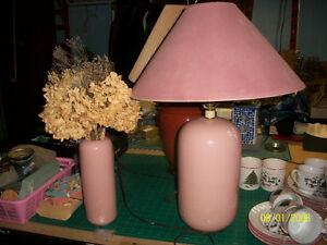 rose colored lamp and vase