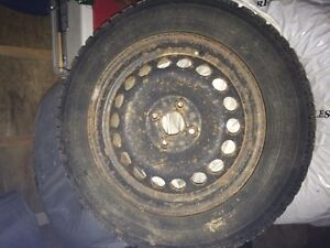 Four used winter tires with steel rims Kitchener / Waterloo Kitchener Area image 1
