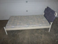Ikea twin/single bed frame and foam mattress.