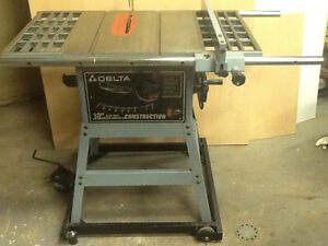 DELTA SAW DOLLY AND TABLE SAW WITH CAST IRON TOP