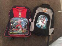 2 power rangers back packs - one trolley wheeled bag