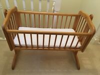 Mothercare swinging wooden crib with mattress and crib sheet