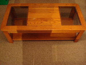 Three oak tables with glass inserts