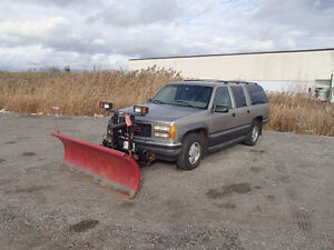 1999 GMC Suburban SLE SUV with Plow