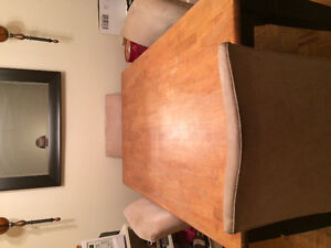 Used solid kitchen table and four fabric chairs New price $140