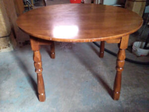 brown round kitchen table, with leaf to extend