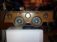 1969-70 COUGAR XR7 DASH GAUGES WITH CLOCK AND WOODGRAIN HOUSING