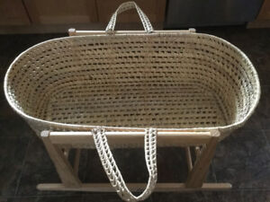 Rocking basket stand with Moses basket.