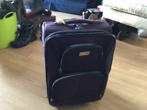 carry on luggage with wheels, expanded zipper, like new