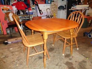 Small wood table and two chairs (no leaf).