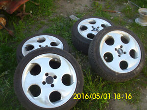 set of 4 used tires on mags