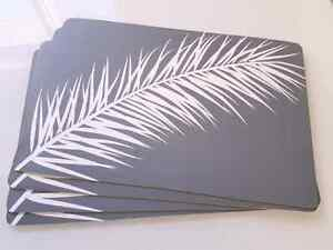 Set of 4 grey and white feather Urban Barn vinyl placemats