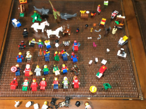 Lego 35 Minifigures Plus Accessories/ parts Horses, sharks, Dino