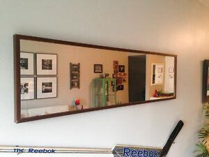 Mirror with dark wooden frame