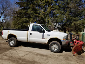 Ford F350 with Boss Plow and Power dump bed