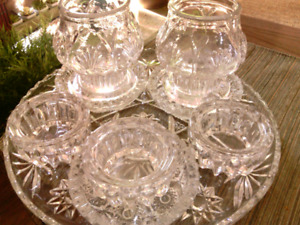 Beautiful 5 pc. decorative cut glass candle holders on tray.