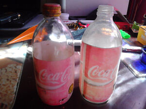 old glass coke bottles...labels are worn but glass good...2 for
