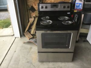 Black stove with stainless steel front