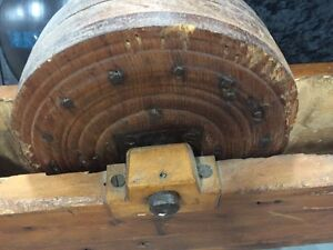Antique wooden gear box, leather working wheel