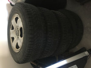 Set of 4 Firestone 215/70R16 Winterforce UV tires on rims!