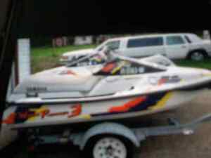 2  jet skis  and trailer trade for skidoo trailet or 1000 cash