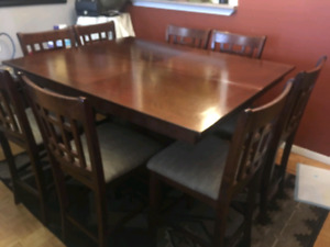 Dining room set, hard wood table and 8 chairs