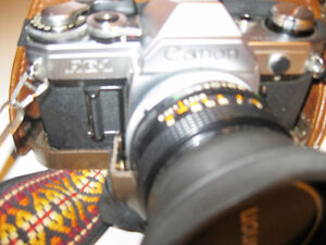 ae-1 canon 35mm  and 50mm lense and 200 mm lense