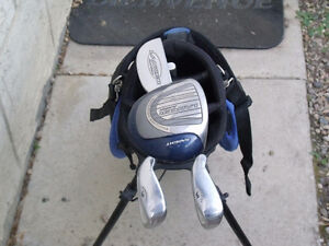 Children's 4 piece set of gulf clubs. Located in Peace River.