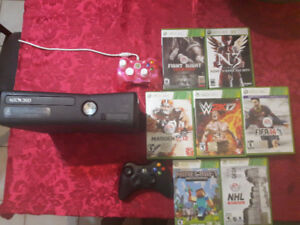 Xbox 360 with 2 controllers and 7 games