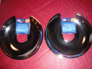 "NEW Stove burner replacement 8"" pans.  $5."