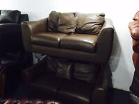 2 brown leather 2 sofas