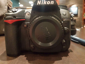 Nikon d7000 and nikon 1:8 mm lens with everything you need to st