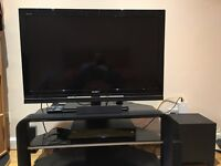 Sony BRAVIA flat screen + stand + Sony Blu-Ray home cinema system