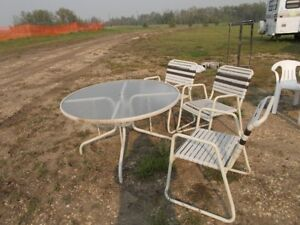 GLASS PATIO TABLE AND 3 CHAIRS