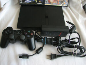 Play Station PS-2 & Two Games