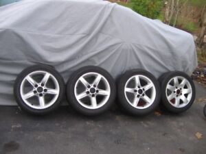 """BMW Factory wheels and tires 16"""" set of 5 $500"""