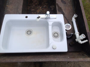 White double sink with faucet