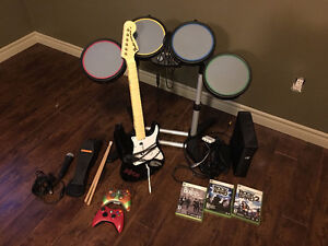Xbox 360 Rockband bundle; 2 wireless remotes and games