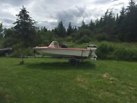 40hp motor with power tilt & trim 14ft boat on ezloader trailer