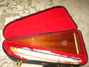 A unique bowed-psaltery with case and instructional disk/book