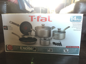 Never used T-FAL 14 piece cookware set, selling for $89.