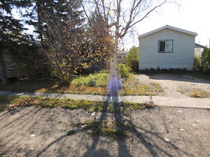 1280 SQ FT MOBILE HOME ON ITS OWN LOT IN CLAIRMONT